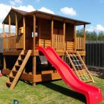 Large elevated cubby house with stained wood